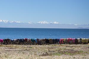 Laundry Hangs on a Wall on Isla Del Sol Along the Edge of Lake Titicaca by Alex Saberi