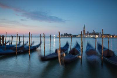 Long Exposure of Blue Gondolas at Dawn with the Church of San Giorgio Maggiore by Alex Saberi
