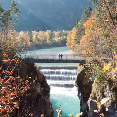 People on a Bridge Over the River Lech and Lechfall, a Man Made Fall by Alex Saberi