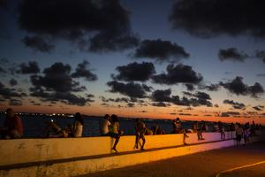 People Sitting on a Wall in Salvador at Dusk by Alex Saberi