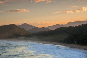 Praia Vermelha Do Centro Surfer Beach and Serra Do Mar State Park in Ubatuba, Brazil by Alex Saberi