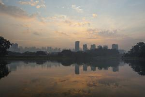 Sao Paulo Cityscape Reflected in the Lake at Ibirapuera Park at Sunrise by Alex Saberi