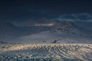 Skaftafellsjokull Glacier with a Mountain During a Dramatic Sunrise by Alex Saberi