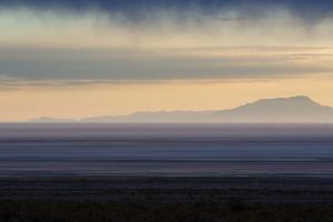 Sunrise over the Salar De Uyuni with Dramatic Clouds by Alex Saberi