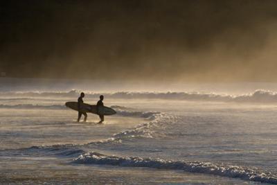 Surfers Make their Way to the Ocean Camburi Beach at Sunrise by Alex Saberi