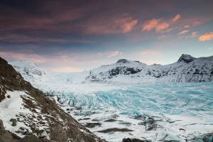 Svinafellsjokull glacier at sunrise in the Skaftafell National Park in southern Iceland. by Alex Saberi