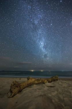 The Milky Way Above Itamambuca Beach at Night and Ship Lights on the Horizon by Alex Saberi