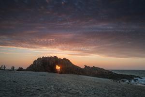 The Setting Sun Viewed Through the Hole at Pedra Furada, Jericoacoara, Brazil by Alex Saberi