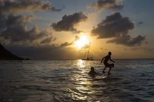 Two Young Boys Attempt to Surf on Praia Da Conceicao Beach at Sunset by Alex Saberi