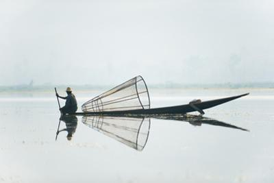 A basket fisherman on Inle Lake scans the still and shallow water for signs of life, Myanmar (Burma by Alex Treadway