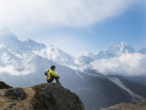 A Hiker Takes a Short Break with Views of Ama Dablam and Kantega by Alex Treadway