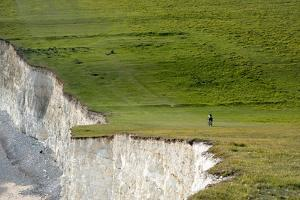A Mountain Bike Cycling the South Downs Way Near Cliffs at Beachy Head by Alex Treadway