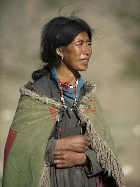 A Nomad Woman Tends to Her Sheep and Goats by Alex Treadway