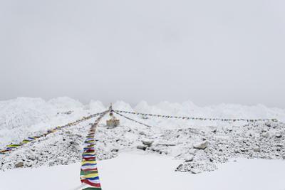 A puja adorned with prayer flags on Khumbu glacier, Everest Base Camp, Khumbu, Nepal, Himalayas by Alex Treadway