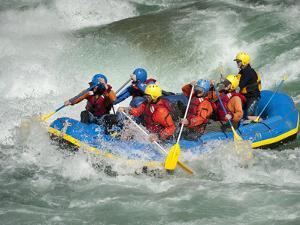 A Raft Goes Through a Big Rapid on the Karnali River in West Nepal by Alex Treadway