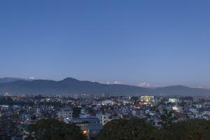 A Rare View of Kathmandu on a Very Clear Night with Views of Ganesh Himal in the Distance by Alex Treadway