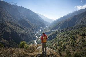A Trekker Pauses Above Tok Tok to Take in the View of the Lukla Valley in the Everest Region by Alex Treadway
