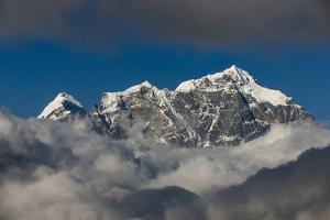A view of Taboche through the clouds seen from Kongde in the Everest region, Nepal, Himalayas, Asia by Alex Treadway