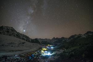 Ama Dablam Base Camp in the Everest Region Glows under Stars with the Milky Way by Alex Treadway