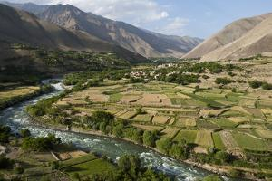 Green of irrigated fields contrast with arid hills, farmers ingenuity in dry landscape, Afghanistan by Alex Treadway