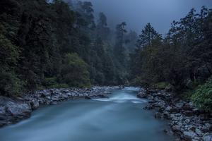 Langtang Khola near village of Riverside on misty evening in Langtang region of Nepal, Himalayas by Alex Treadway
