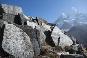 Mani Stones Inscribed with an Ancient Tibetan Mantra in the Khumbu Valley by Alex Treadway