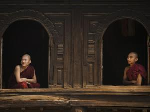 Monks Look Out from the Windows of a Wooden Monastery in Myanmar by Alex Treadway
