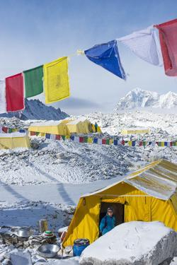 Prayer Flags and the Everest Base Camp at the End of the Khumbu Glacier That Lies at 5350M by Alex Treadway