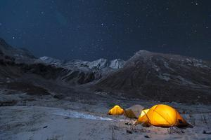 Stars Sparkle in the Sky Above Yellow Tents in Juphal Valley, Dolpa Region of Nepal by Alex Treadway