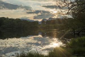 Sunset at Loughrigg Tarn Near Ambleside in the Lake District by Alex Treadway