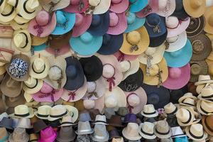 Traditional Panama hats and Sombreros for sale at a street market in Cartagena, Colombia by Alex Treadway