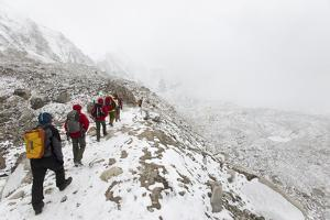 Trekkers Walking into Everest Base Camp, a Distant Set of Tents on the Khumbu Glacier, Nepal by Alex Treadway