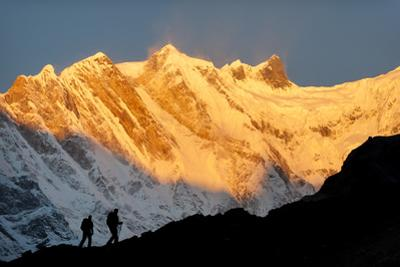 Two Trekkers Walk in Front of Annapurna by Alex Treadway