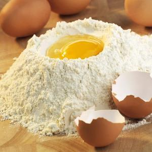 Baking Ingredients: Egg in Well in Mound of Flour by Alexander Feig