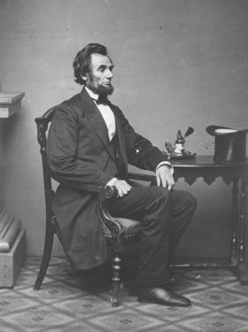 Abraham Lincoln, full-length portrait, seated, 1861 by Alexander Gardner