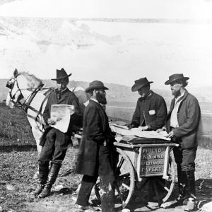 Men Purchasing Newspapers by Alexander Gardner