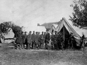 US Pres. Abraham Lincoln Standing on Campsite with Group of Federal Officers on Battlefield by Alexander Gardner