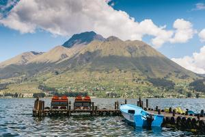 A pier and boat at the base of Volcan Imbabura and Lago San Pablo, close to the famous market town  by Alexandre Rotenberg