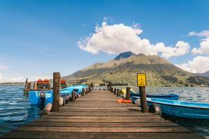 A pier and boat on Lago San Pablo, at the base of Volcan Imbabura, close to the famous market town by Alexandre Rotenberg