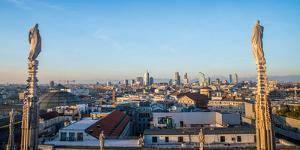Downtown Milan as seen through the roof of the city's famous Duomo cathedral, Milan, Lombardy, Ital by Alexandre Rotenberg