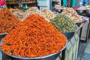 Spices and fruits in a traditional market in Jerusalem, Israel, Middle East by Alexandre Rotenberg