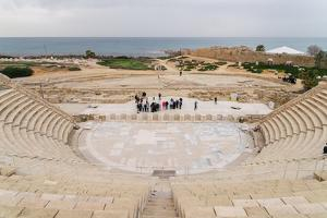 The ancient Roman amphitheatre in Caesarea, Israel, Middle East by Alexandre Rotenberg