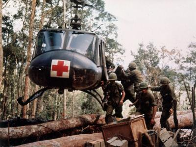 """American 4th Battalion, 173rd Airborne Brigade Soldiers Loading Wounded Onto a """"Huey"""" Helicopter by Alfred Batungbacal"""