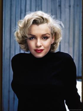 Actress Marilyn Monroe Posing at Home in Her Backyard by Alfred Eisenstaedt