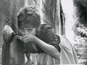Actress Sophia Loren Drinking Water from Spigot During the Filming of Madame Sans Gene by Alfred Eisenstaedt