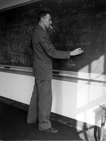American Physicist J. Robert Oppenheimer Writing on Blackboard at the Institute for Advanced Study