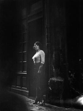 Atmospheric of Parisienne Prostitute Standing Near Doorway on Street by Alfred Eisenstaedt