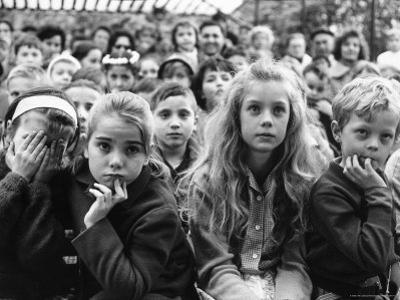 Audience of Children Sitting Very Still, with Rapt Expressions, Watching Puppet Show at Tuileries by Alfred Eisenstaedt