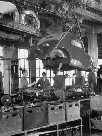 "Body Being Lowered on to ""Topolino"" Chassis by Workers on Assembly Line at Fiat Production Plant by Alfred Eisenstaedt"