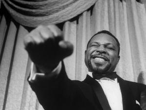 Boxer Archie Moore Demonstrating Punch by Alfred Eisenstaedt